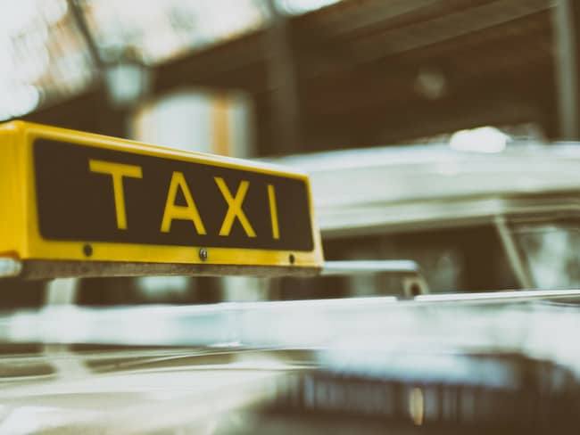 Travel Glitches and How to Solve Them Taxi Sign on Cab