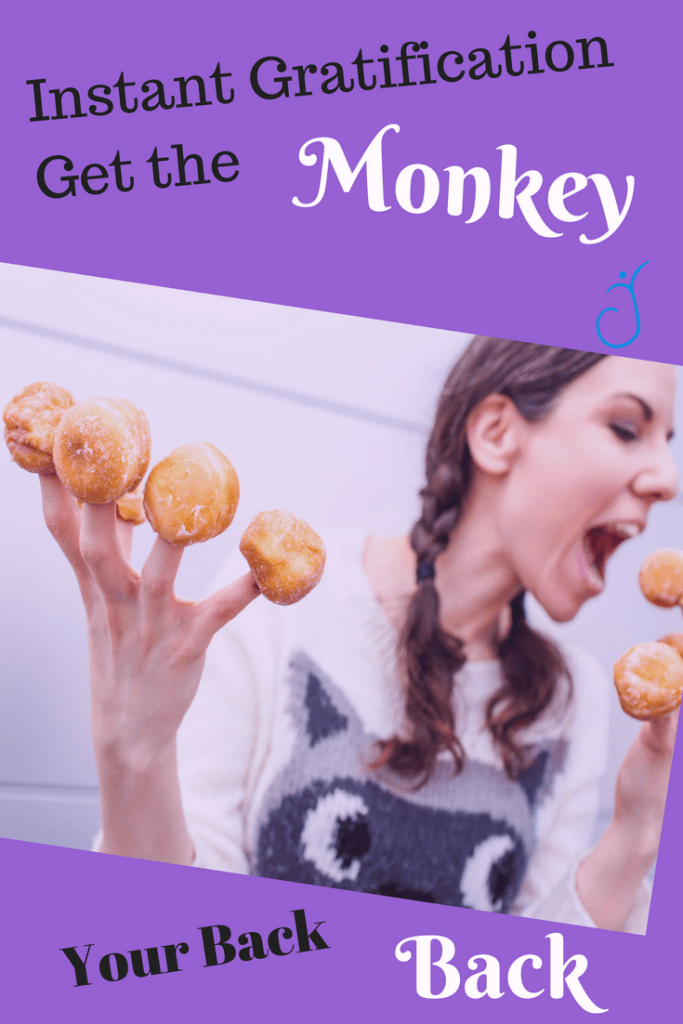 woman eating donut holes she has stuck on all her fingers.