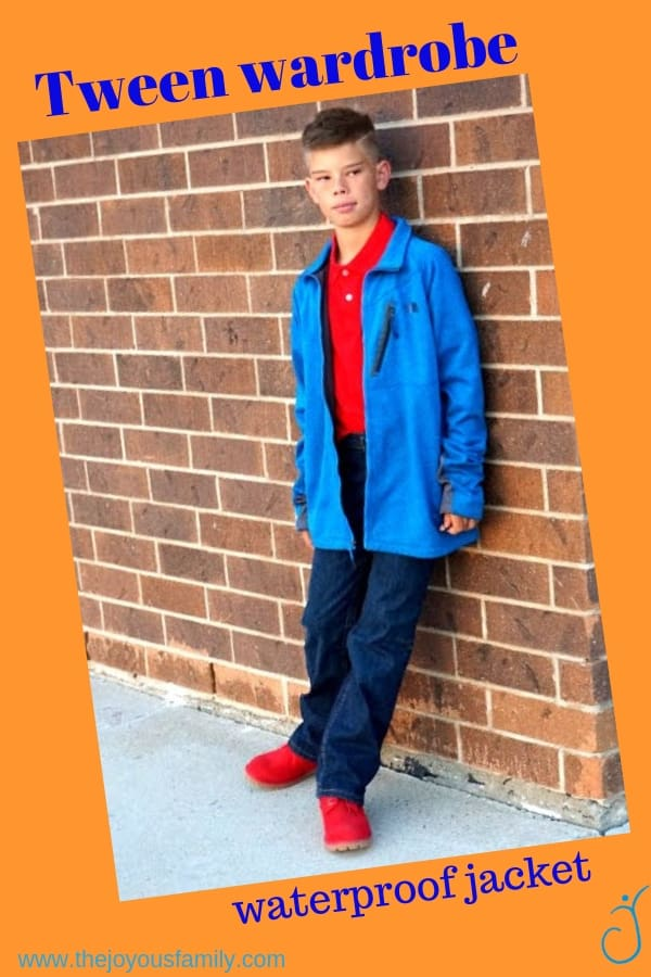 Tween Boy in travel clothes. Blue coat, red polo shirt and dark jeans plus fun red shoes.